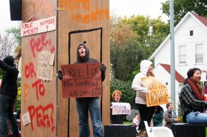 Upcoming Concordia Urinetown displayed some of their set in the homecoming parade. Photo by Chase Body.