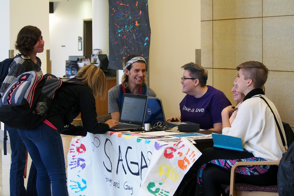 SAGA members manned a table in the Atrium during Coming Out Week. Concordia students could stop by to get a photo taken of them with a whiteboard message related to LGBTQ issues. Photo by Morgan Schlief.