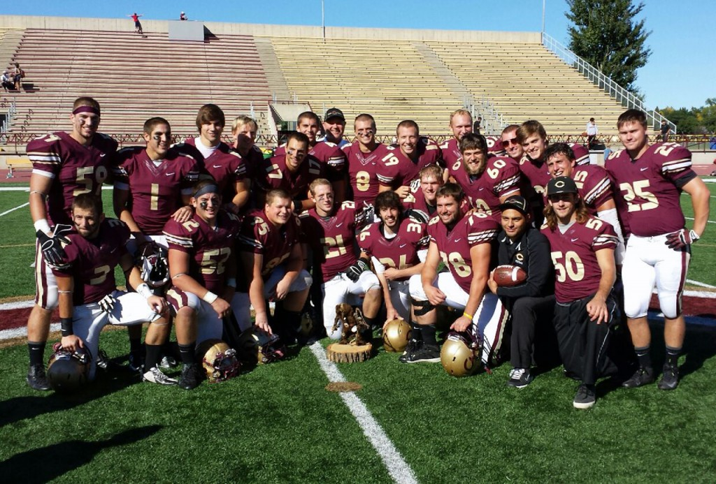 Senior football players pose with The Troll trophy.  Photo submitted by Roger Tamm.