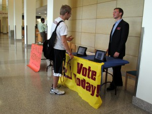 SGA President Levi Bachmeier encouraging people to vote for their class representative. Photo by Aubrey Schlied.