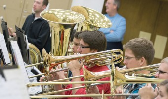 """Seniors Isaac Helath, senior Bryce Frentz and freshman Jonathon Sutton practice for the upcoming Prism concert. This year's concert wil revolve around the theme """"America."""" The concert will be Nov. 17 in Memorial Auditorium. Photo by Chase Body."""