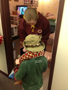 The young zookeeper receives candy from a Park Region resident during Concordia's Halloween tradition of opening resident halls for trick-or-treaters. Photo by Jordan Elton.