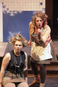 Freshman Rachel Hogen and Senior Liz Rahn sing as members of the poor people in the town. Photo curtesy of Jen Thomas.
