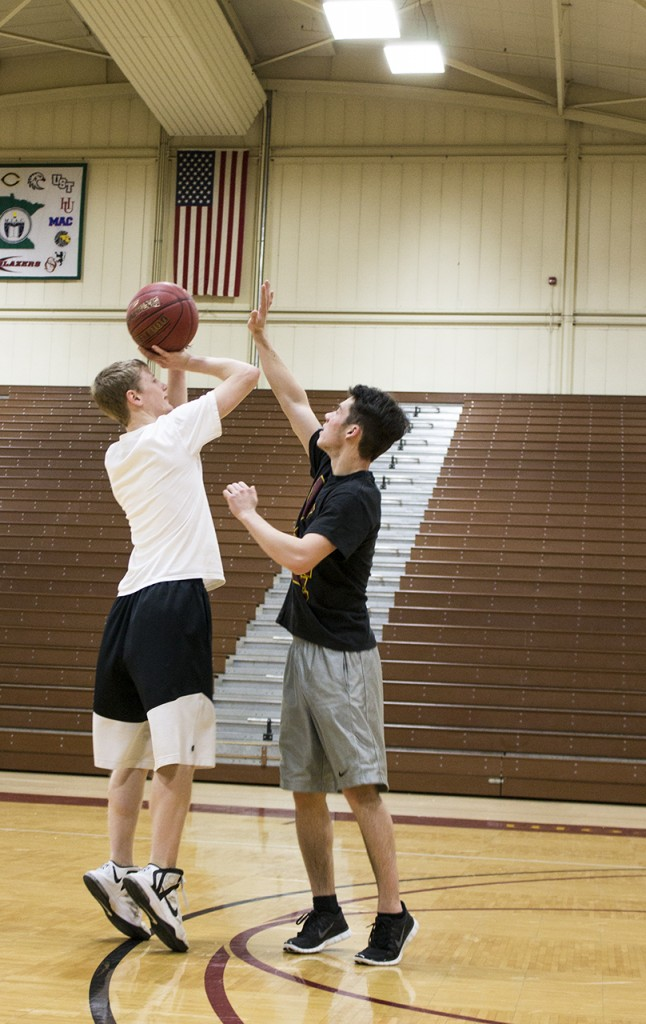 Two Concordia intermural players practice basketball together.