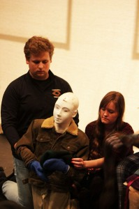 Jonathan Wells and Lisa Uppman work with their bunraku puppet. Below: Actors practice the Suzuki Meth- od with Director David Wintersteen.