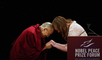 Anastasia Young and the Dalai Lama meet onstage at the Nobel Peace Prize Forum earlier this month. Photo courtesy of Nobel Peace Prize Forum.