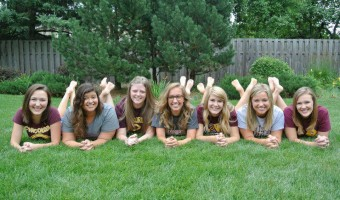 Kylie Windecker hangs with her Cobber Family. Submitted photo.