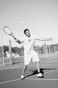 Cobber tennis player Isaac Toivonen returns a serve to start the volley.  Photo by Maddie Malat.