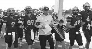 Coach Horan leads Concordia's football team to a win over Bethel. Photo by Maddie Malat.