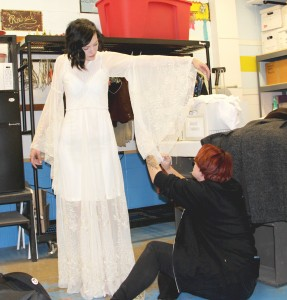 "Alicia Auch getting fitted for her role in ""Dracula"" by Costume Designer, Katie Curry. Photo by Reilly Myklebust."