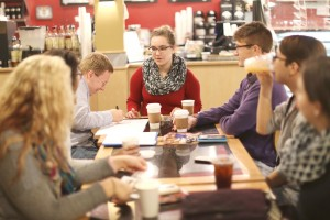 Executive borad member Natalie Dulca shares coffee and thoughts with Caleb Christiansen, Noah Bray and other club members during the Coffee and Tea intersectional event for Feminism Club. Photo by Maddie Malat.
