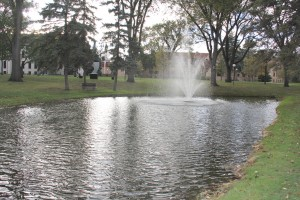 Facilities pumps city water into Prexy's Pond. Photo by Reilly Myklebust.