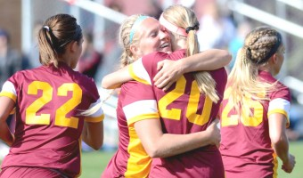 Sadie Hayes rejoices with a teammate after a goal during Saturday's game. Photo courtesy of the Concordia Sports Information Office.