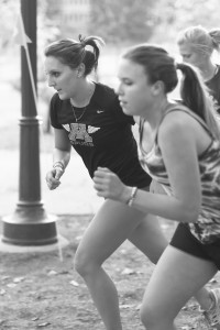 Co-captain Mackenzie Randklev runs alongside teammate Olivia Hamilton. Photo by Maddie Malat.