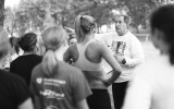 Coach Marvin Roeske explains a workout to the team. Photo by Maddie Malat.
