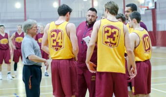The men's basketball team prepares for a season with shorter shot clocks. Photo by Maddie Malat.