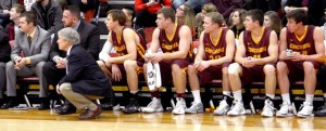 Left to right, assistant coaches Matt Petersen, Grant Hemmingson and head coach Rich Glass watch the game alongside the basketball team. Photo courtesy of the Concordia Sports Information Office.