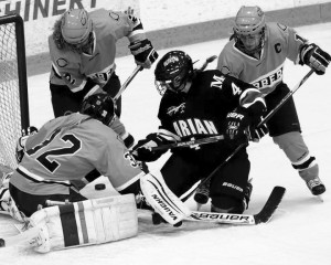 Women's hockey players block a shot against Marian University Nov. 29. Photo courtesy of the Concordia Sports Information Office.
