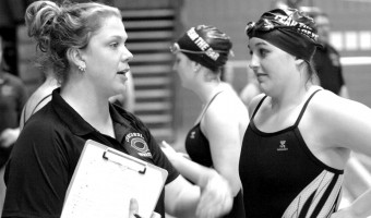 Head coach Talia Butery advises senior captain Jordyn Olson. Photo courtesy of the Concordia Sports Information Office.