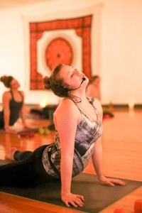Sophomore Hannah Steffen leads a weekly hot yoga class for college students. Photo by Maddie Malat.
