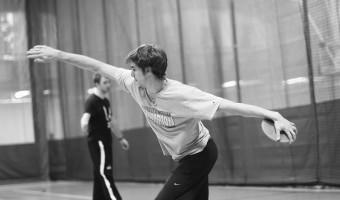 Senior Gabe Wright throws discus during a practice. Photo by Maddie Malat.