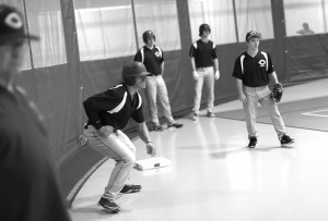 Men's baseball players began their season Feb. 1, with the team practicing indoors because of weather. The men's home season opening game is scheduled for March 28 against Jamestown. Players and coaches are hopeful that the weather will cooperate with their game schedule. Photo by Maddie Malat.