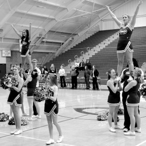Cobber cheerleaders practice stunting. Men and wom- en on the team have varying experience levels. The student-led team welcomes anyone to tryout March 7 through 10 in Olson Forum. Photo submitted by the Concordia College Sports Information Office.