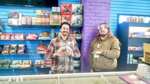 From left to right: Brothers and owners of The Dragon's Hoard, Jordan and Alex Tepley advertise a variety of their Magic trading cards. Photo by Kaley Sievert.