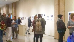 Students gather in Cyrus M. Running Gallery during the opening of the exhibition. Photo by Kaley Sievert.