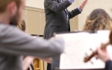 Beyers directs the Concordia Orchestra during a rehearsal. Photo by Maddie Malat.