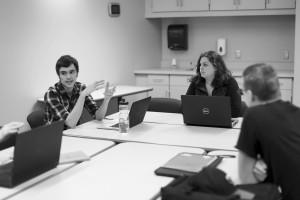 Co-Presidents Colin Johnson and Madison Lindquist discuss an exercise for writing action scenes. Photo by Maddie Malat.
