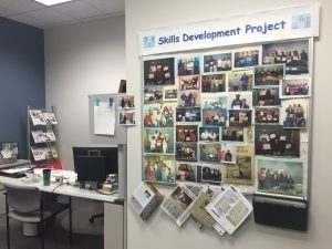 A bulletin board demonstrates a handful of students that have graduated from the Skills Development Project. Photo by Aubrie Odegaard.