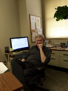 Jack Zaleski sits in his office at The Forum. Photo by Marit Johnson.