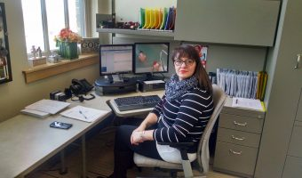 Jasmine Gehrig sits at her desk at Family Medical Center. Photo by Kaley Sievert.