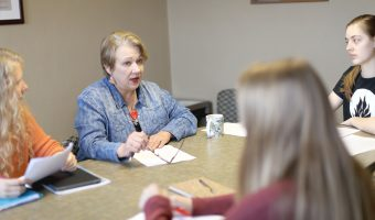 Cathy provides students with feedback during a feature writing class. Photo by Maddie Malat.