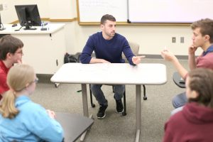 Alejandro Piqué, Spanish department native assistant, leads a conversation group with Spanish students. Photo by Maddie Malat.