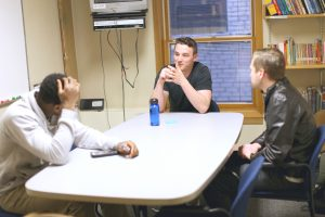 Baptiste Aufrère, French department native assistant, talking with students. Photo by Maddie Malat.