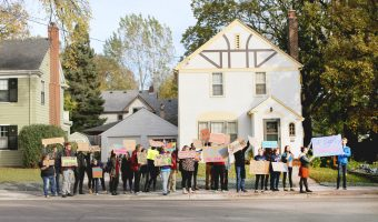 Concordia and MSUM students march with posters along 8th street. Photo by Maddie Malat.