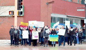 Community members march at the intersection of Broadway Dr. and Second Avenue in Downtown Fargo. Photo submitted by Morgan Schleif.