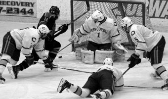 Cobbers men hockey battles against Hamline during a home game. Photo courtesy of Sports Information Office.