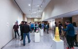 People admire students' artwork at the opening of the gallery. Photo by Maddie Malat.