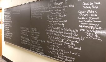 On the second floor in Fjelstad lies the chalk board displaying pre-med students' accomplishments. Photo by Maddie Malat.