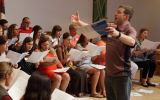 Dr. Michael Culloton rehearses with the MASLC alumni choir. Photo courtesy of Concordia College