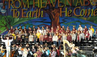 Dr. Clausen rehearses with the choirs and orchestra