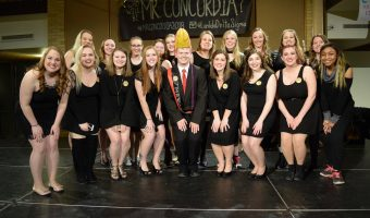 Members of Lambda Delta Sigma pose with the newly crowned Mr. Concordia, Tyler Eliason. Photo by Abby Carlson.