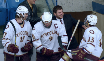 Coach Howe (top right) celebrates with his team. Photo courtesy of Cobber SID.