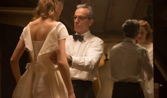 "Garment maker Reynold Woodcack (Daniel Day-Lewis) fits a dress for Alma (Vicky Krieps) in ""Phantom Thrad."" Anapurna Pictures."