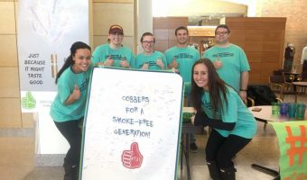 Students in Dr. Cindy Larson-Casselton's Health Communications course tabled in the Atrium last week to gain support for raising the legal age for purchasing tobacco products to 21. Photo courtesy of Sarah Strand.