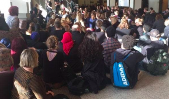 Students staged a walk out in protest of racist posters hung on campus. AMENA CHAUDRY.